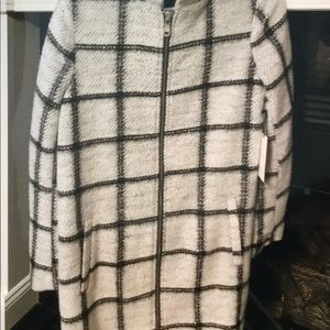 Black and white light weight zipper front coat.